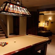 A Billiard table in a hall center lightened up with Home Automation solutions